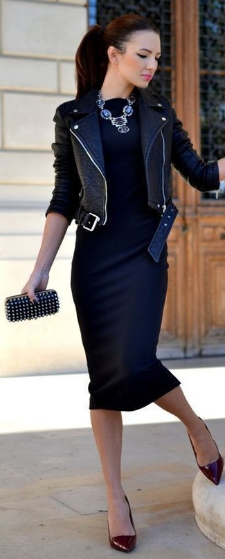 For an outfit that provides comfort and style, reach for a black leather biker jacket and a dark blue bodycon dress. Dark red leather pumps will instantly elevate even the laziest of looks. When leaves are falling down and fall is in full swing, you'll appreciate how great this outfit is for transeasonal weather.