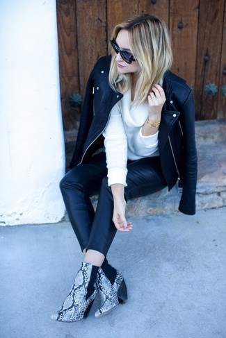 How to wear: black leather biker jacket, white cowl-neck sweater, black leather skinny pants, grey snake leather ankle boots