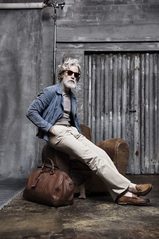 How to wear: blue suede biker jacket, grey crew-neck sweater, beige dress pants, brown leather loafers