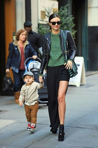Miranda Kerr wearing Black Quilted Leather Biker Jacket, Green Crew-neck Sweater, Black Slit Maxi Skirt, Black Chunky Leather Ankle Boots