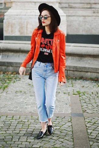 A red leather biker jacket and grey sunglasses will convey a carefree, cool-girl vibe. Black leather loafers will instantly smarten up even the laziest of looks. An ensemble like this is great for winter-to-spring weather.