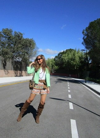 How to wear: mint boucle biker jacket, white crew-neck t-shirt, multi colored print shorts, dark brown suede knee high boots