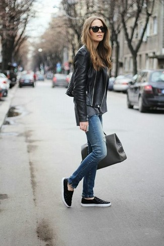 If you're a fan of classic pairings, then you'll like this combination of a black leather biker jacket and blue destroyed slim jeans. Black leather slip-on sneakers will add some edge to an otherwise classic look.