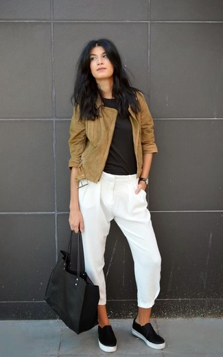 A brown suede biker jacket and white silk skinny pants feel perfectly suited for weekend activities of all kinds. A pair of black leather slip-on sneakers will be a welcome addition to your getup. This combo is absolutely great to welcome the springtime.