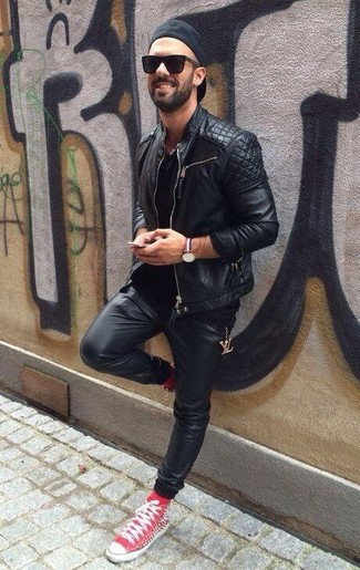 How to wear: black quilted leather biker jacket, black crew-neck t-shirt, black leather sweatpants, red high top sneakers