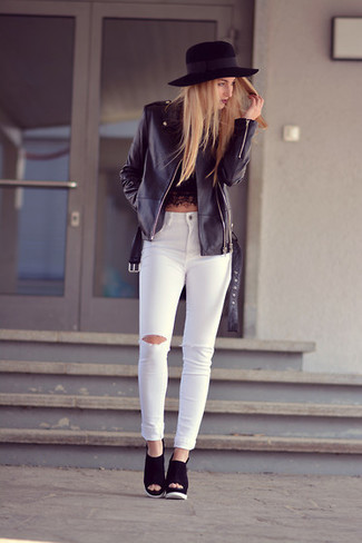 How to wear: black leather biker jacket, black lace cropped top, white ripped skinny jeans, black suede wedge sandals