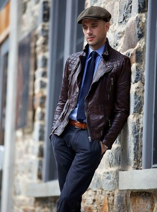 How to wear: dark brown leather biker jacket, blue dress shirt, navy chinos, charcoal flat cap