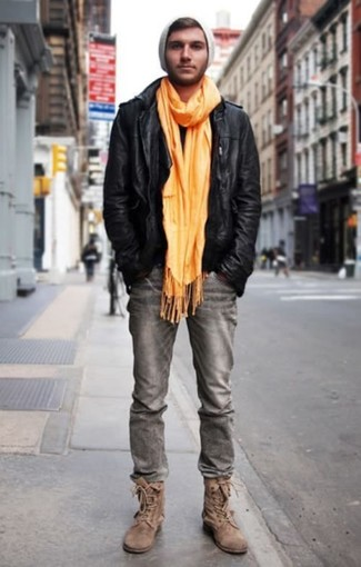 How to wear: black leather biker jacket, grey jeans, brown suede casual boots, grey beanie