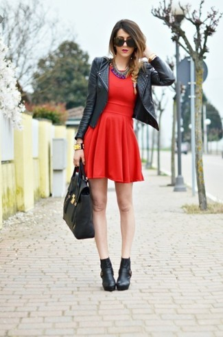 How to wear: black leather biker jacket, red skater dress, black leather ankle boots, black leather tote bag