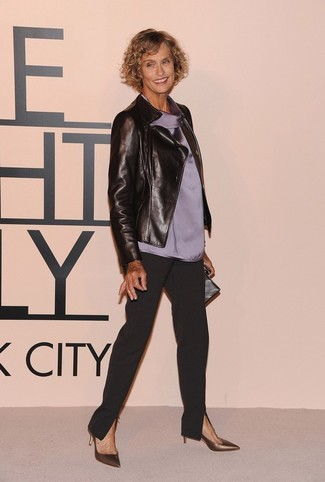 Lauren Hutton wearing Black Leather Biker Jacket, Grey Silk Sleeveless Top, Black Tapered Pants, Gold Leather Pumps