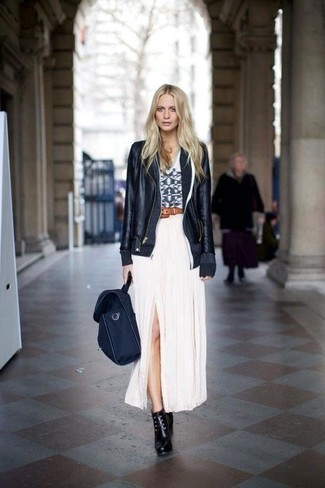 Show off your playful side in a black leather motorcycle jacket and a white pleated maxi skirt. Elevate this outfit with black leather lace-up ankle boots. With springtime in the air, it's time to sport simple and chic getups, just like this one.
