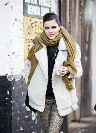 How to wear: white wool biker jacket, navy turtleneck, dark brown crew-neck sweater, brown print skinny pants