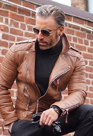 How to wear: brown leather biker jacket, black turtleneck, black dress pants, black leather gloves