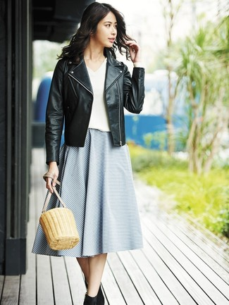 How to wear: black leather biker jacket, white v-neck sweater, blue horizontal striped full skirt, black suede ankle boots
