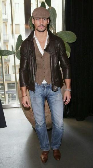 How to wear: dark brown leather biker jacket, brown waistcoat, white dress shirt, blue jeans