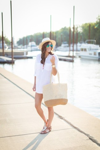 How to Wear a Beige Straw Hat For Women: Opt for a white shirtdress and a beige straw hat, if you prefer to dress for comfort but also like to look cool. A pair of brown embellished leather flat sandals is a good idea to finish your outfit.