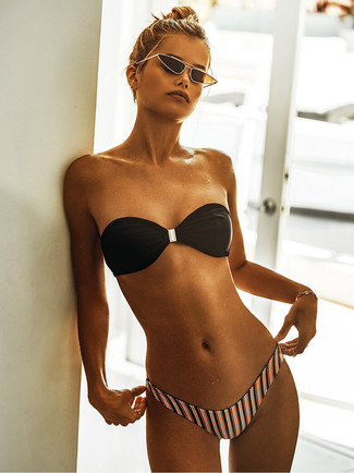 How to wear: gold bracelet, black and gold sunglasses, multi colored vertical striped bikini pant, black bikini top