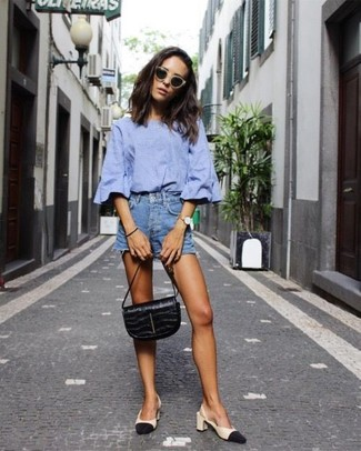 How to wear: black leather handbag, black and tan leather pumps, blue denim shorts, light blue short sleeve blouse