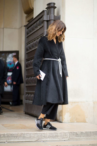 How to wear: white leather clutch, black and white athletic shoes, black culottes, black fur coat