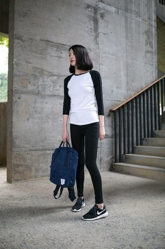 How to wear: navy backpack, black and white athletic shoes, black skinny jeans, white and black long sleeve t-shirt