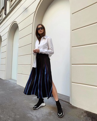 How to wear: black and white athletic shoes, black vertical striped midi skirt, white dress shirt