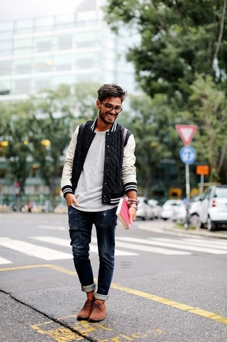 How to wear: black and white bomber jacket, grey crew-neck t-shirt, navy jeans, brown suede desert boots