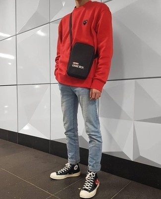 How to wear: black and white canvas high top sneakers, light blue jeans, red sweatshirt
