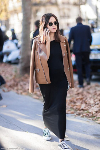 How to wear: black and white canvas low top sneakers, black maxi dress, brown leather biker jacket