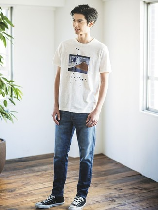 How to wear: black and white canvas low top sneakers, navy jeans, white print crew-neck t-shirt