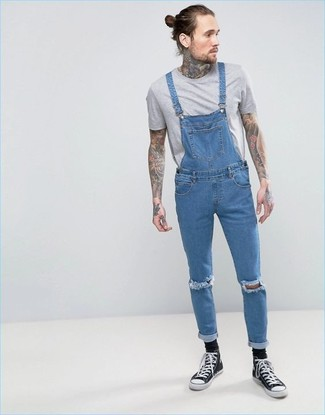 How to wear: black socks, black and white canvas high top sneakers, blue denim overalls, grey crew-neck t-shirt