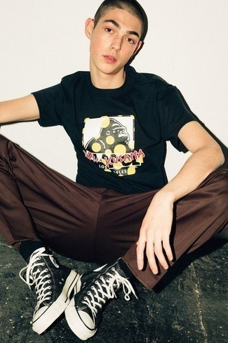 Teen Boy Fashion: What To Wear: For a casual getup, try pairing a navy print crew-neck t-shirt with brown chinos — these items fit really cool together. Black and white canvas high top sneakers will add a whole new dimension to your outfit. Perfect if you're hunting for some incredibly inspiring teenage laid-back style.