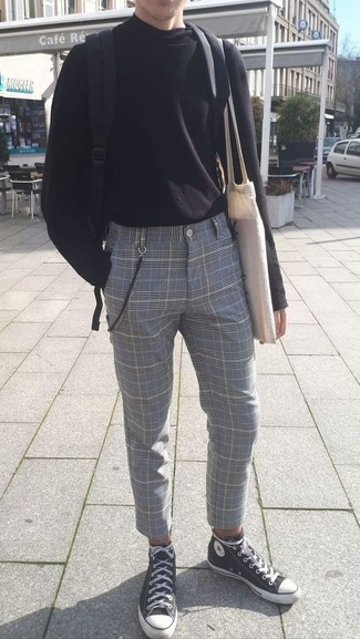 How to wear: black canvas backpack, black and white canvas high top sneakers, grey plaid dress pants, black turtleneck