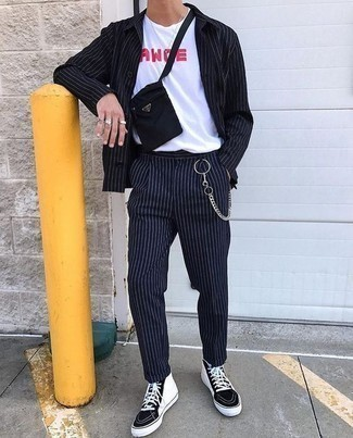 How to Wear a Black Vertical Striped Suit: Perfect the effortlessly classy ensemble in a black vertical striped suit and a white and red print crew-neck t-shirt. Not sure how to finish? Introduce black and white canvas high top sneakers to your look to shake things up.
