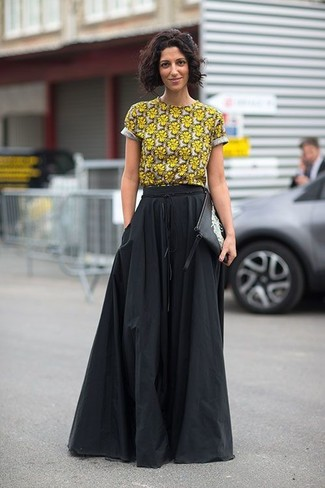 How to wear: black and white print leather clutch, black pleated maxi skirt, yellow floral crew-neck t-shirt