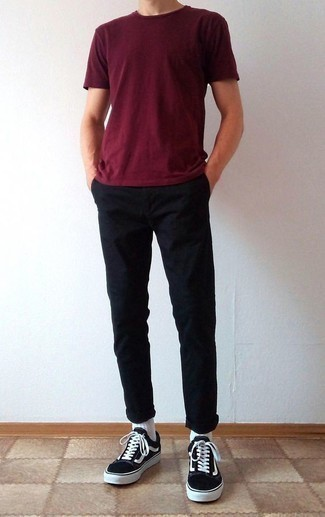 How to Wear Black and White Canvas Low Top Sneakers For Men: If you gravitate towards laid-back style, why not try this combination of a burgundy crew-neck t-shirt and black chinos? Add black and white canvas low top sneakers to the equation and the whole look will come together.