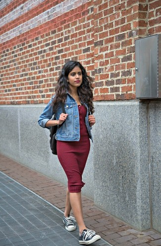 How to wear: black backpack, black and white canvas low top sneakers, burgundy bodycon dress, blue denim jacket