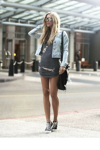 How to wear: black leather crossbody bag, black and white canvas low top sneakers, charcoal bodycon dress, light blue denim jacket