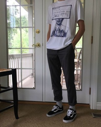 Men's Looks & Outfits: What To Wear In 2020: If the situation permits a casual ensemble, you can wear a white and navy print crew-neck t-shirt and charcoal chinos. Complement your outfit with black and white canvas low top sneakers for maximum style.