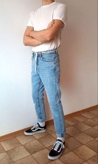 How to Wear a White Crew-neck T-shirt For Men: This combo of a white crew-neck t-shirt and light blue jeans is extremely easy to put together and so comfortable to wear a variation of throughout the day as well! Black and white low top sneakers complete this ensemble quite nicely.