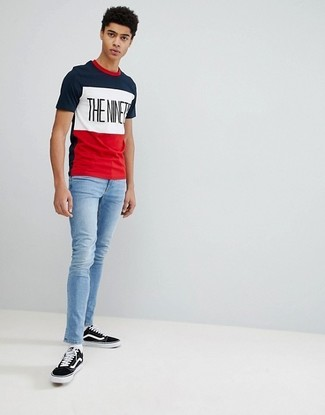 How to wear: white socks, black and white canvas low top sneakers, light blue skinny jeans, white and red and navy print crew-neck t-shirt