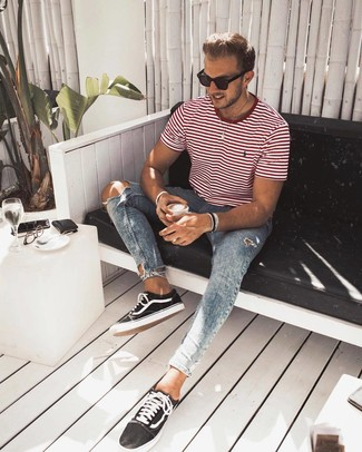 How to wear: black sunglasses, black and white canvas low top sneakers, light blue ripped skinny jeans, white and red horizontal striped crew-neck t-shirt