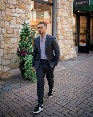 How to wear: grey socks, black and white leather low top sneakers, white and purple vertical striped dress shirt, charcoal wool suit