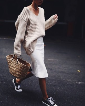 How to wear: tan straw tote bag, black and white low top sneakers, white pencil skirt, beige knit oversized sweater