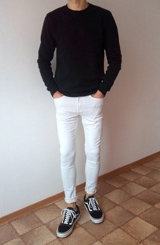 How to Wear White Skinny Jeans For Men: To create a relaxed outfit with an edgy spin, marry a black long sleeve t-shirt with white skinny jeans. Want to play it up when it comes to footwear? Round off with a pair of black and white canvas low top sneakers.
