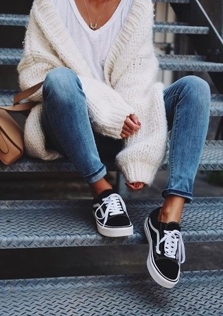 How to wear: tan leather crossbody bag, black and white canvas low top sneakers, white v-neck t-shirt, white knit open cardigan