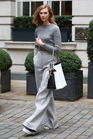 How to wear: white and black leather tote bag, black and white leather platform loafers, grey wool wide leg pants, grey cropped sweater