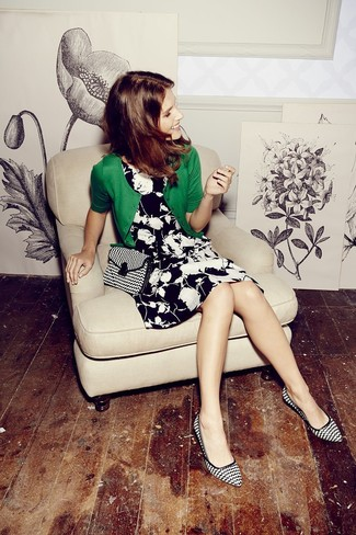 How to wear: black and white canvas crossbody bag, black and white print leather pumps, black and white floral skater dress, green cardigan