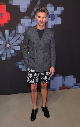 Fashion for Men Over 50: What To Wear: If the dress code calls for an effortlessly classic look, you can rely on a charcoal double breasted blazer and black and white print shorts. Complete this getup with black leather double monks to instantly shake up the ensemble.