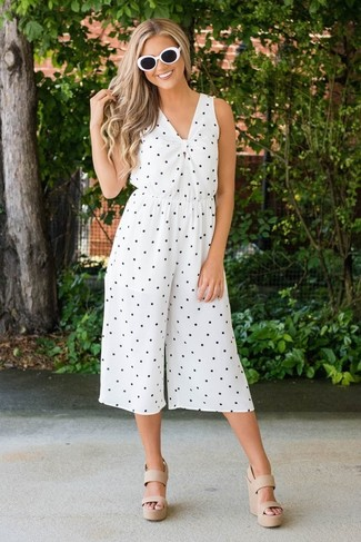 How to wear: black and white sunglasses, beige leather wedge sandals, white and black polka dot jumpsuit