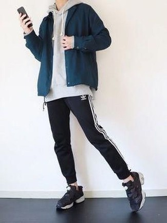 Men's Looks & Outfits: What To Wear In Fall: Why not marry a navy shirt jacket with black and white sweatpants? Both of these pieces are super functional and look nice worn together. Black athletic shoes are a surefire way to bring a sense of stylish nonchalance to this look. This ensemble is the definition of ideal for when leaves are falling down and temps are falling.